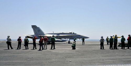 Preparing to strike ISIL: A Hornet readies for takeoff