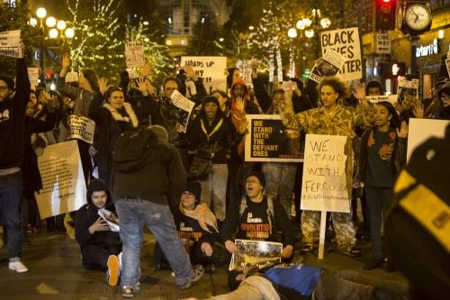 Seattle demonstrators protest Missouri grand jury's failure to return a verdict in Michael Brown shooting
