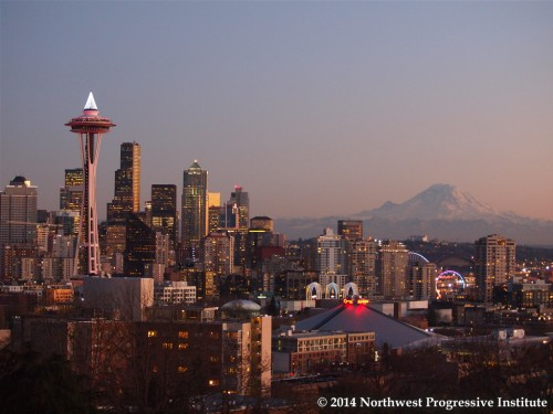 Seattle skyline glows on New Year's Eve as sun sets