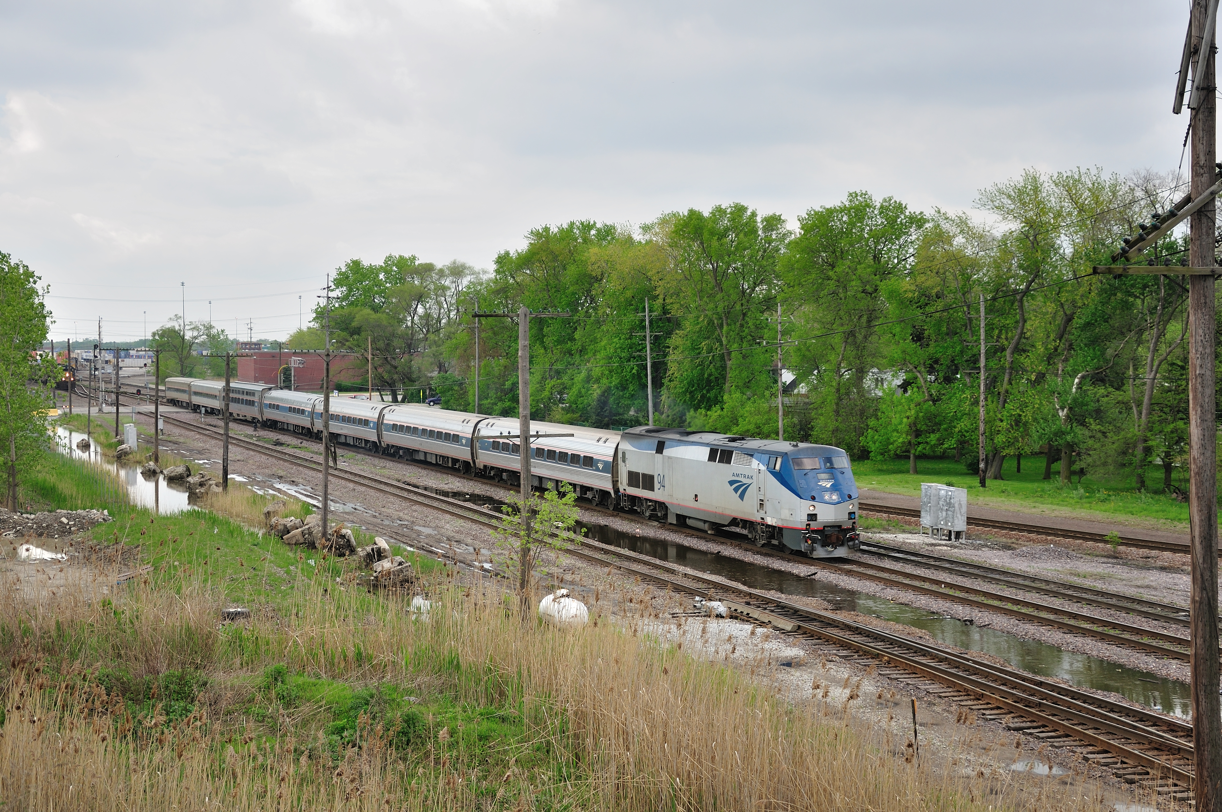 An Amtrak train rolls along towards its destination