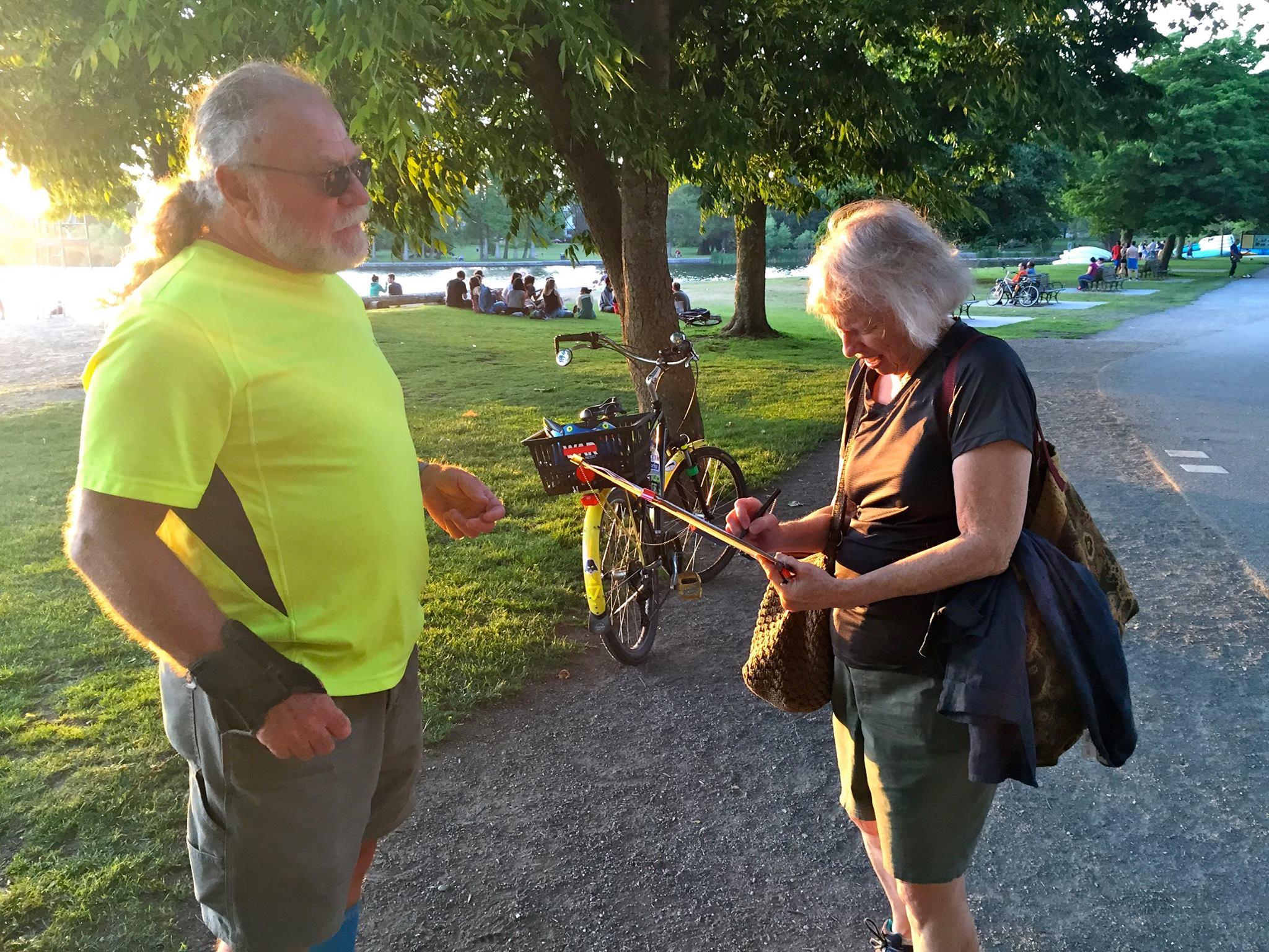 Gathering signatures for I-735 at Green Lake