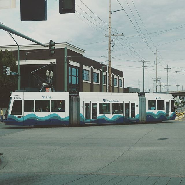 A Tacoma Link streetcar turns towards Freighthouse Square