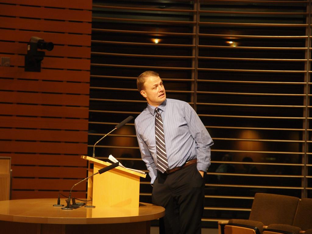 Tim Eyman at a podium in Bellevue