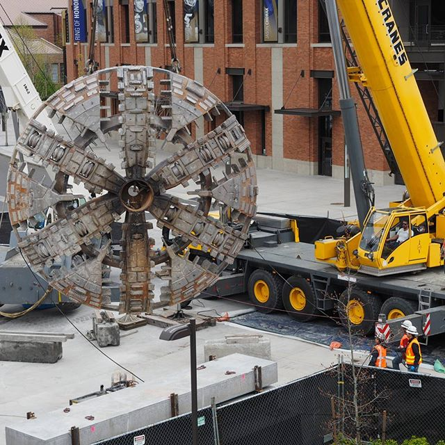 Workers maneuver the cutterhead for Sound Transit's North Link tunnel boring machine #1 at Husky Stadium