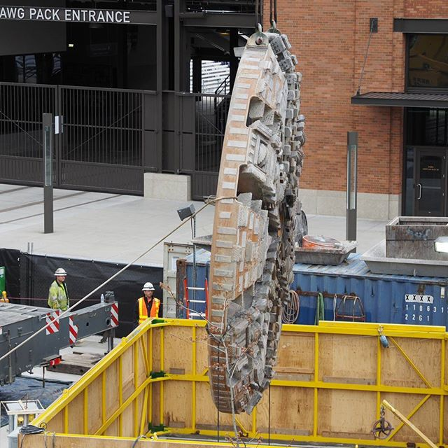 Here comes the cutterhead: Workers remove the first part of the tunnel boring machine that drilled from Northgate