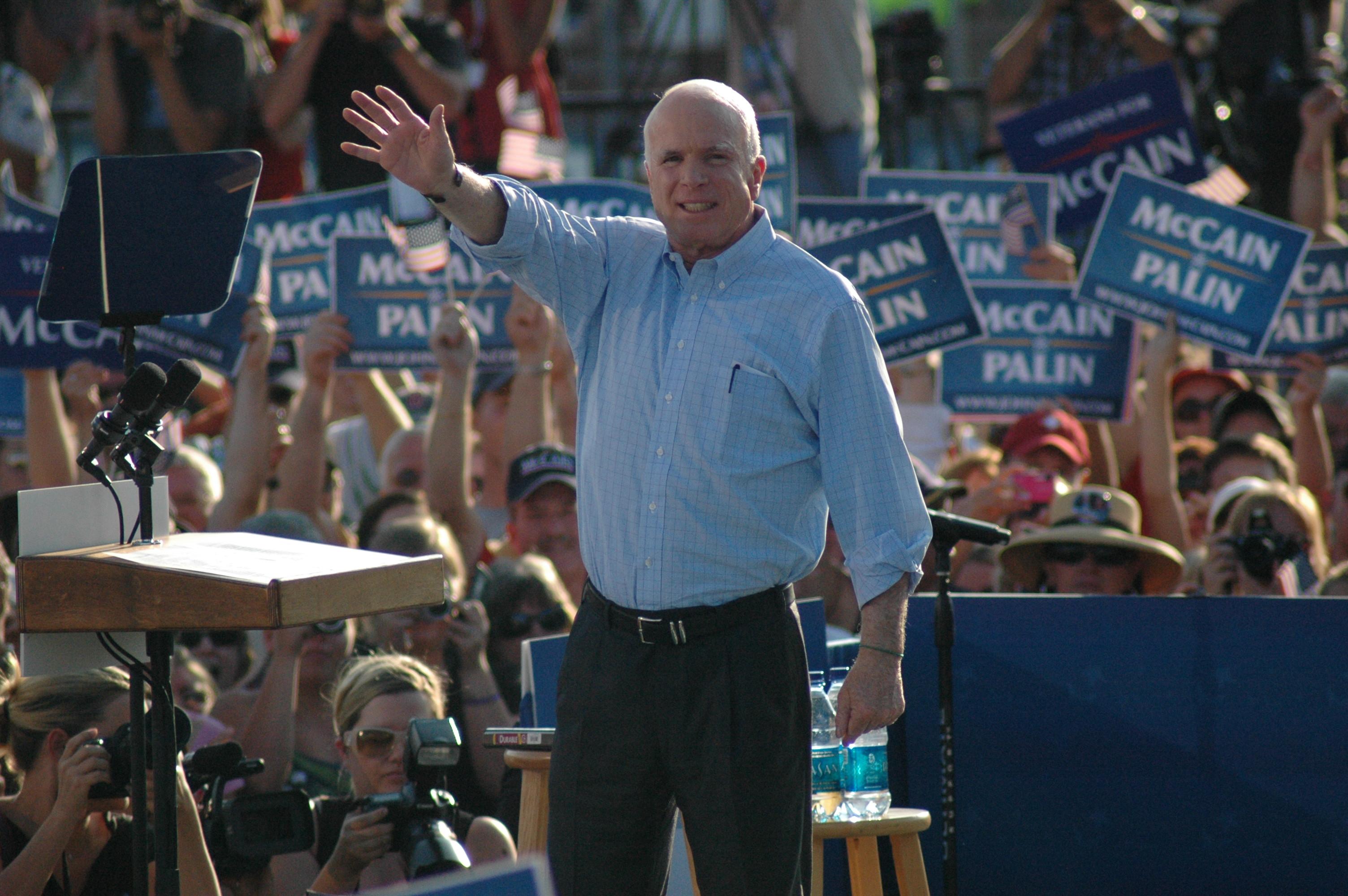 John McCain waving