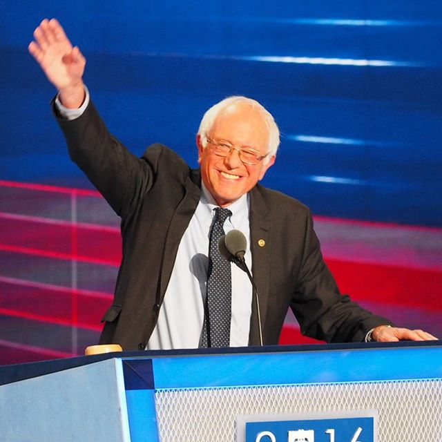 Senator Bernie Sanders waves to cheering supporters prior to delivering a speech in support of Hillary Clinton and the progressive revolution