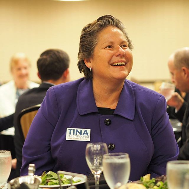 Democratic Secretary of State candidate Tina Podlodowski enjoys a light moment with her tablemates at the thirtieth annual Eastside Democratic Dinner