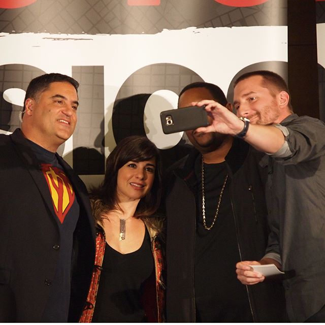 During a break in taping, the hosts of The Young Turks take a photo with Seattle rapper Sir Mix-a-Lot