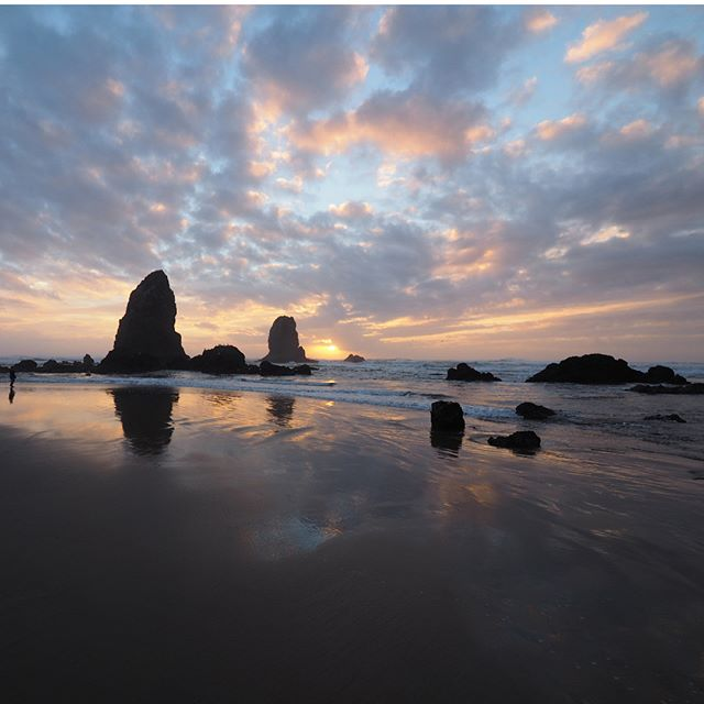 Sunset at Cannon Beach on a warm November day, with The Needles in the foreground