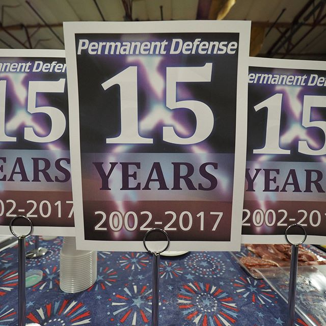 Placards at the Permanent Defense Fifteenth Anniversary Celebration