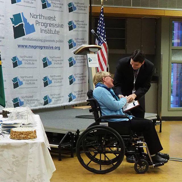 NPI founder Andrew Villeneuve presents Sound Transit CEO Emeritus Joni Earl with a Lynn Allen Award