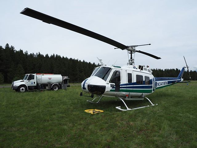 A UH-1 firefighting Huey parked at DNR's Cle Elum helibase, with fuel truck in the background