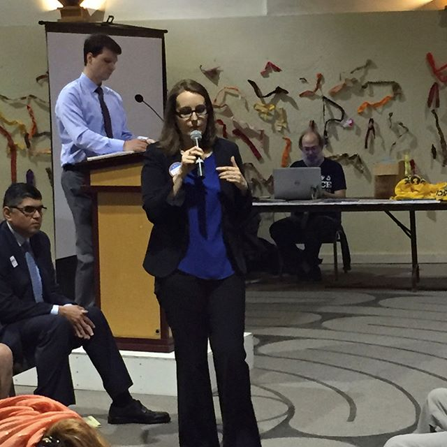 Melissa Wingard-Phillips Taylor speaks at yesterday's special nominating caucus in the 46th Legislative District; she was placed second on the list of nominees drawn up by precinct committee officers