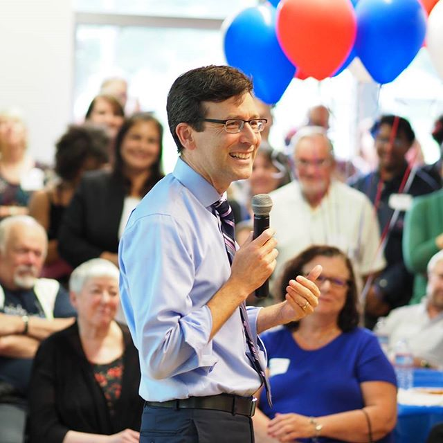 Attorney General Bob Ferguson addresses supporters at his annual Shrimp Feed