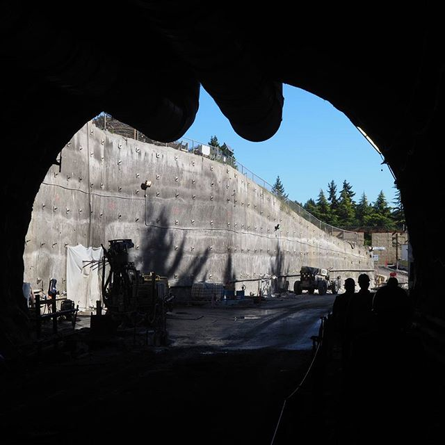 Inside Sound Transit's downtown Bellevue construction zone: Daylight illuminates the trench at tunnel's end