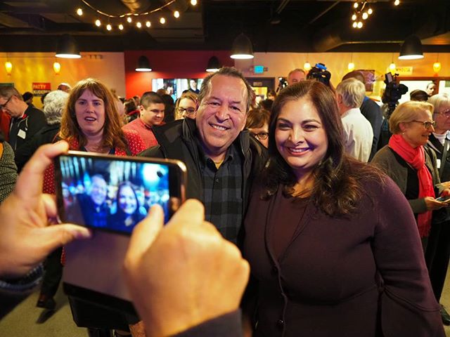 Senator-elect Manka Dhingra takes a photo with a supporter at her victory party
