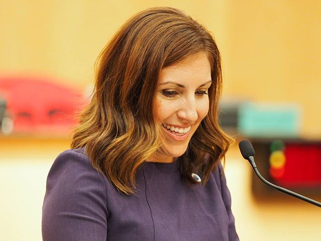 New Seattle City Councilmember Teresa Mosqueda smiles midway through her inauguration speech