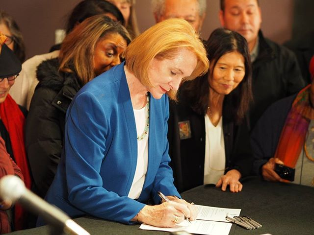 Seattle Mayor Jenny Durkan signs an executive order affirming the city's commitment to the Race and Social Justice Initiative