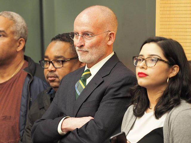 Seattle Mayor Emeritus Tim Burgess looks on as Teresa Mosqueda is sworn in