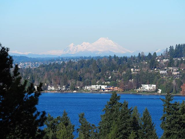 Mount Baker is visible in the distance beyond Lake Washington on a clear December day