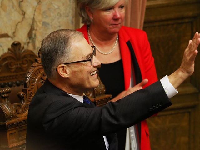 Governor Inslee waves to the galleries following the conclusion of his 2018 State of the State Address