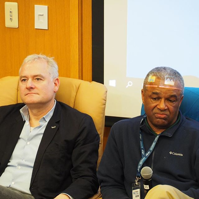 """Sen. Reuven Carlyle and Ron Sims listen while another panelist speaks during """"Tax breaks for titans"""" discussion at #crosscutfest"""