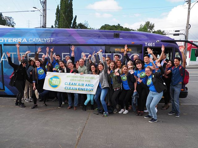 All aboard! Yes on I-1631 supporters prepare to board an Olympia-bound Proterra Catalyst E2 electric bus to turn in signatures