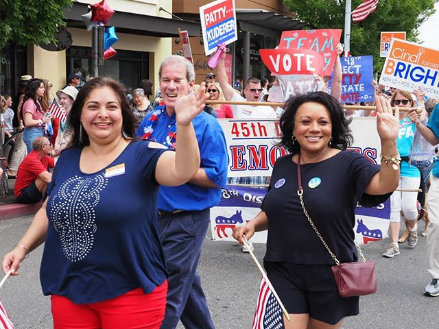 State Senator Manka Dhingra (D-45th District) and 48th District House hopeful Cindi Bright round the final corner of Kirkland's Fourth of July Hometown Heroes Parade