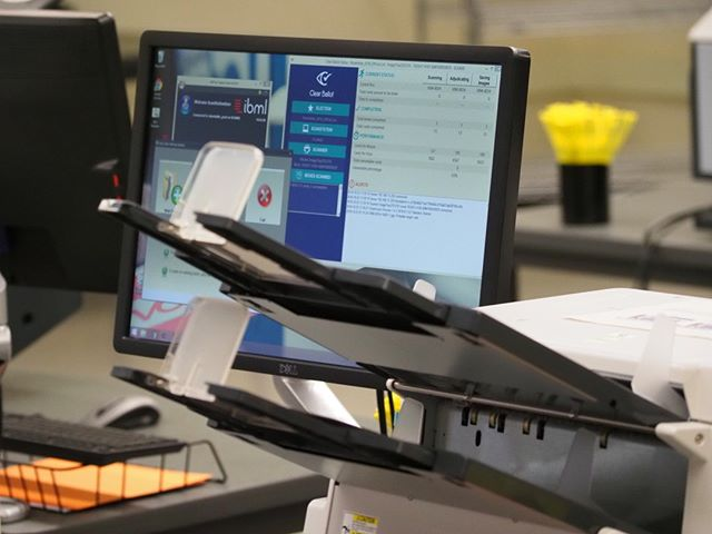 """Inside King County Elections: State of the art scanners are used to create images of ballots; the manufacturer of these ImageTracDS 1210 scanners says they are capable of capturing """"up to 210 pages per minute (ppm) at 200 dots per inch (dpi) or 300 dpi"""""""