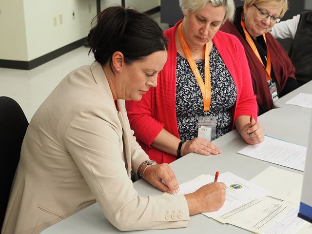 Inside King County Elections: Director Julie Wise signs a form certifying that King County successfully carried out its 2018 general election Logic & Accuracy Test