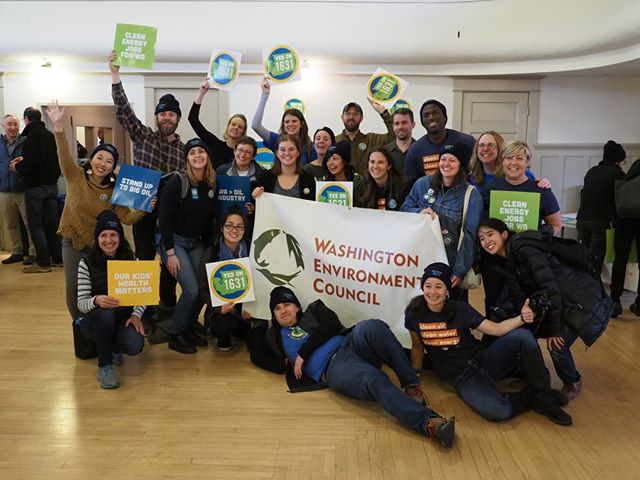 Washington Environmental Council leaders celebrate their work to pass Initiative 1631 following a Get-Out-The-Vote rally