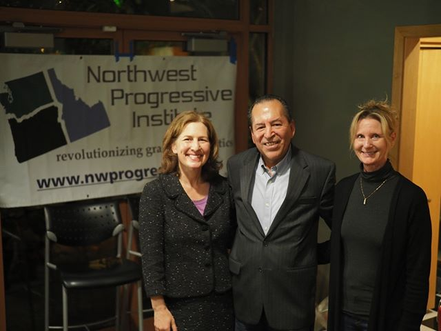 Scenes from NPI's 2018 Winter Holiday Party: Dr. Kim Schrier, Senator Patty Kuderer, and Carlos Jimenez take a photo
