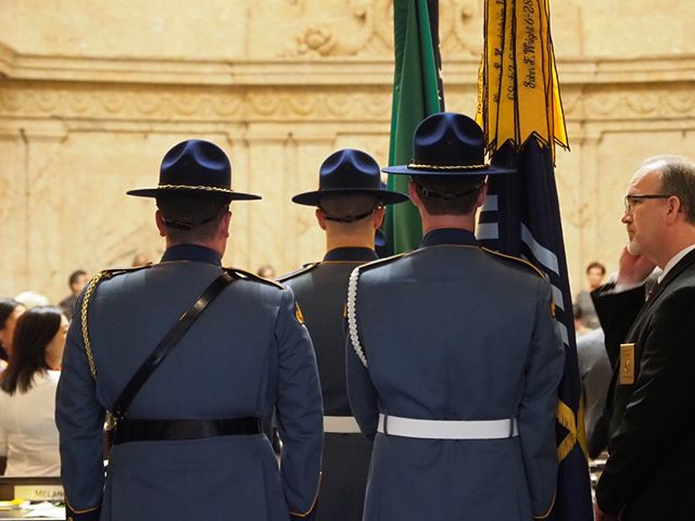 Scenes from the first day of the 2019 Legislative Session in Olympia: The State Patrol color guard proceeds into the House Chamber