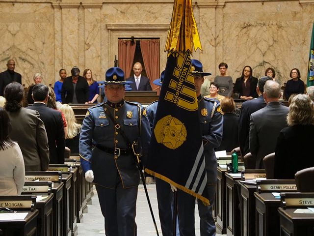 Scenes from the first day of the 2019 Legislative Session in Olympia: The State Patrol color guard exits the House Chamber after the presentation of the colors