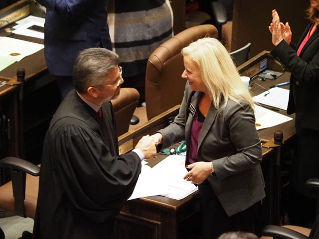 2019 State of the State Highlight: Newly reelected Justice Steven Gonzalez greets Representative Mari Leavitt
