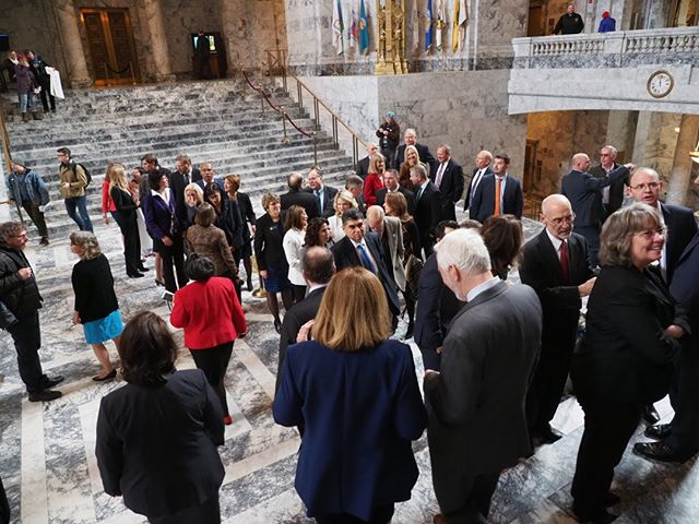 Scenes from the first day of the 2019 Legislative Session in Olympia: New and returning members of the House, including NPI's Gael Tarleton, gather in the rotunda prior to their swearing in