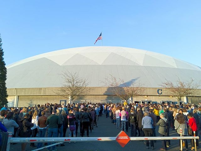 "People wait in line to see Michelle Obama at the Tacoma Dome on the Washington State stop of her ""Becoming"" tour"