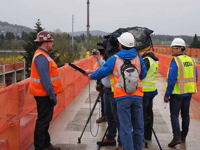 Sound Transit's Chad Frederick is interviewed atop the East Link guideway about the progress of construction