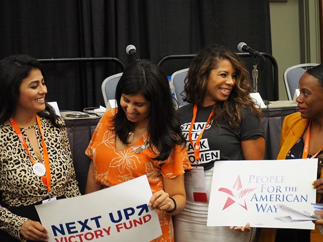 Panelists Sammi Brown, Elora Diaz, Anna Eskamani, and Summer Lee prepare to take a photo after Young Women of Color Winning Elections, a panel at #NN19