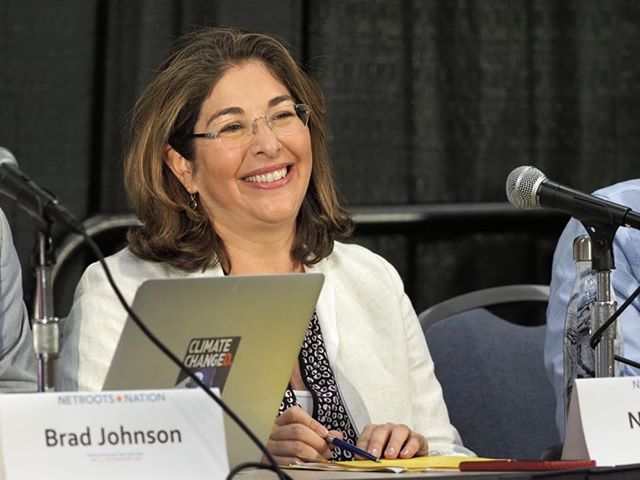 """Naomi Klein shares a lighthearted moment with fellow panelists at the conclusion of """"Making the Green New Deal Real"""" #NN19"""