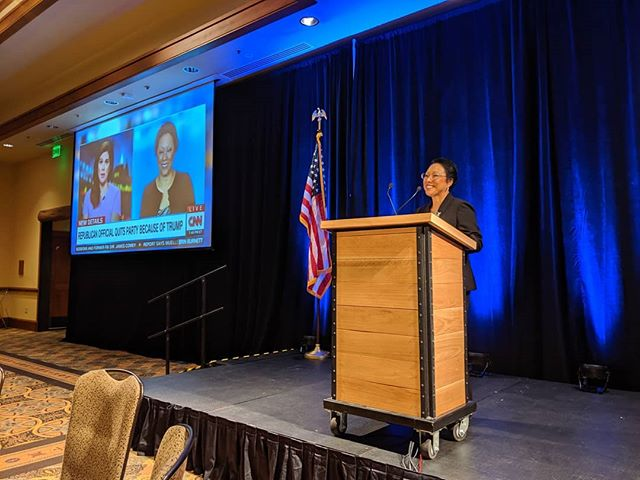 Multnomah County Commissioner Lori Stegmann watches a CNN report about her decision to quit the Republican Party, renounce Donald Trump, and join the Democrats #OregonSummit