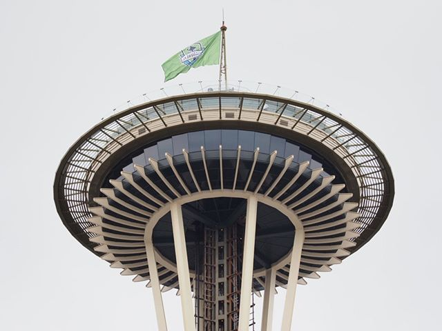 Scenes from the 2019 Sounders' championship parade: The Space Needle flies the team flag