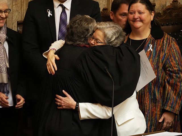 New House Speaker Laurie Jinkins embraces retiring Justice Mary Fairhurst after taking the oath of office