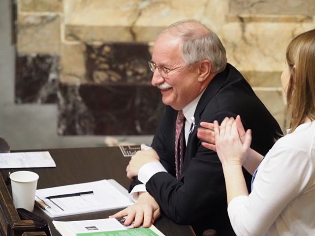 State Representative Frank Chopp smiles as he is recognized for his contributions to the State of Washington as Speaker of the House for two decades