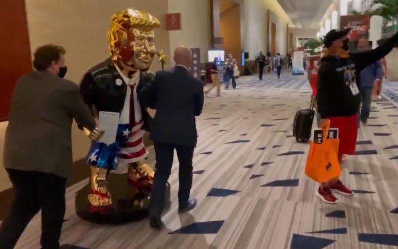 Trump fans wheel a golden statue of him through CPAC