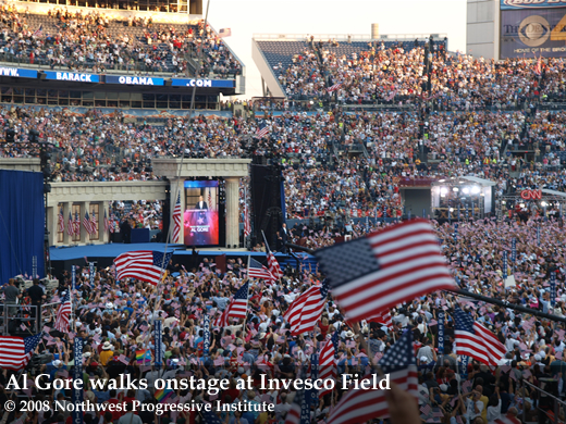 Al Gore walks onstage at Invesco Field