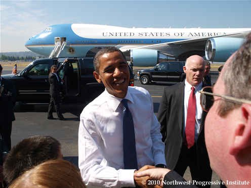 President Obama waves upon arrival in Seattle