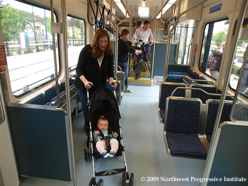 Mother with a child and stroller aboard Link