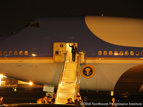 President Barack Obama waves as he exits Air Force One